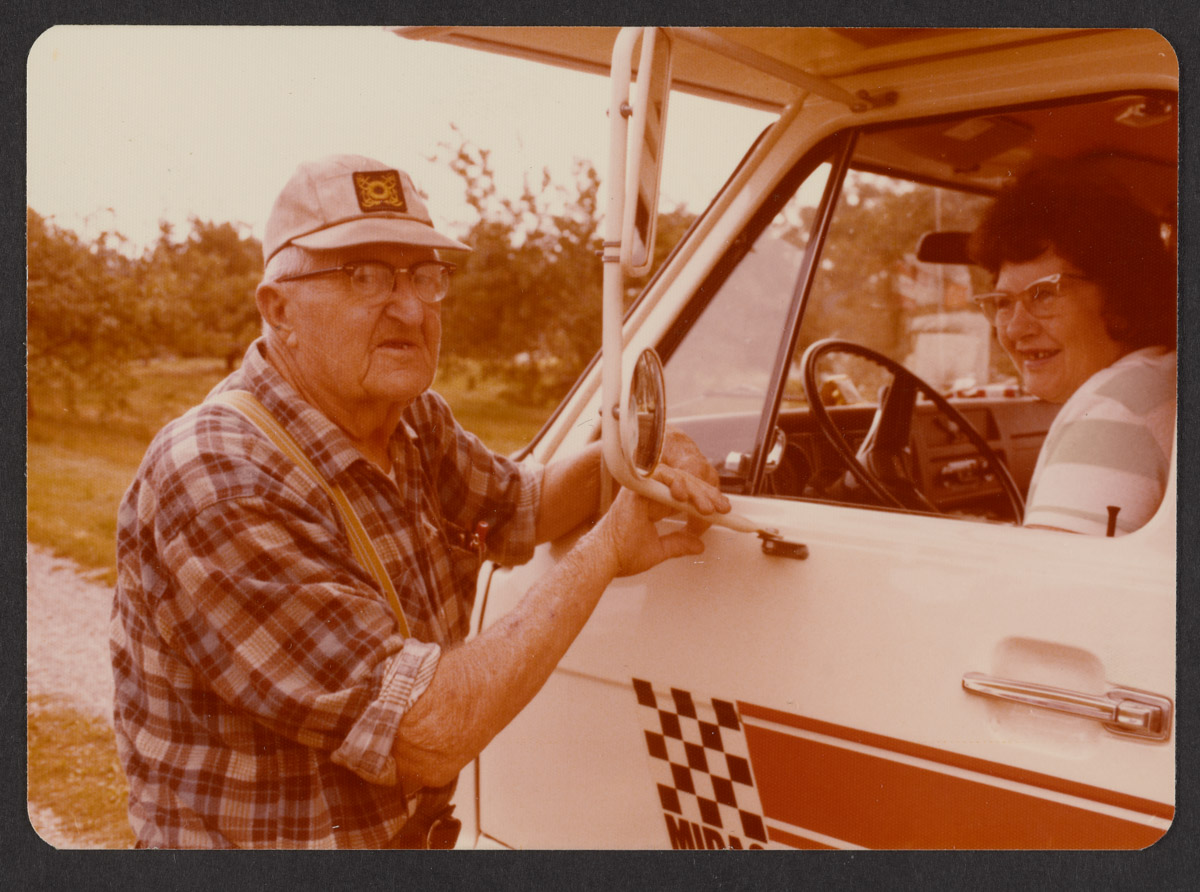 Hank Grindle and Woman in Truck Photograph, 1977